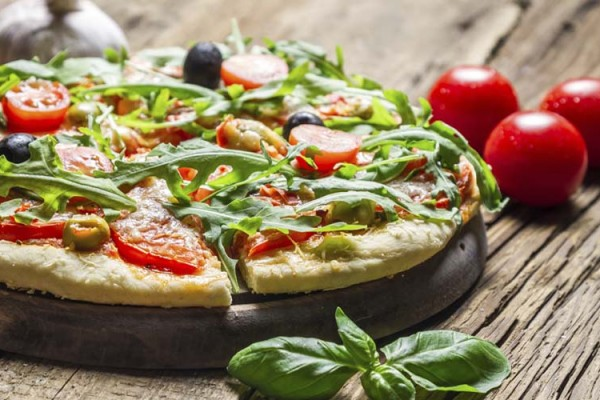 Freshly baked pizza with basil and tomatoes